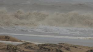 Waves crashing on a beach. Photo: Madhusmit Pati