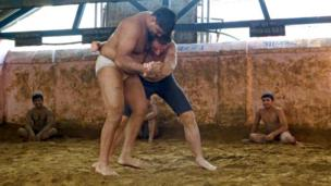 Mark Beaumont wrestling in the akhara