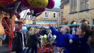 Laura Doherty with 1-year-old son Max and balloon seller Matt Richards