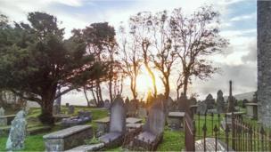 This graveyard view westwards at sunset was taken by the Reverend Roger Pitman from Llangeinor, near Bridgend