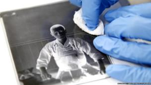Cleaning a fragile glass negative