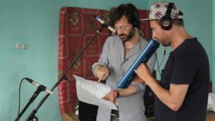 Andre de Ridder and Damon Albarn. Photo taken by Manuel Toledo, BBC Africa