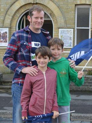 Teacher Mark Gainey with his sons, Joe, eight, and Alex, nine