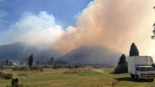 In this photo provided by the New South Wales Rural Fire Service, smoke rises from a fire near Lithgow, west of Sydney, on 17 October 2013