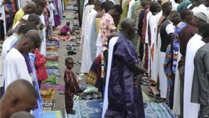 A boy is seen at Eid prayers in Abidjan, Ivory Coast - Tuesday 15 October 2013