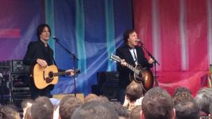 Paul McCartney on stage in Covent Garden, London, UK as he plays a pop up lunchtime gig. Photo: John Deol