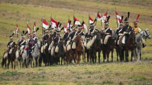 Participants playing the part of Polish Lancers arrive at the re-enactment of the Battle of Leipzig (20 October)