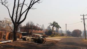 A home and car destroyed by bushfire in Winmalee pictured on 21 October 2013