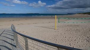 October sunshine at Portrush Strand, County Antrim - by Mervyn Robb