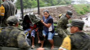 Mexican soldiers help evacuate residents as Hurricane Raymond approaches,