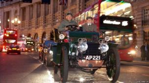 A 1903 Daimler is driven in London's Regent Street