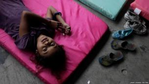 A child, who was evacuated during Hurricane Raymond, rests at a school used as a shelter in Zihuatanejo