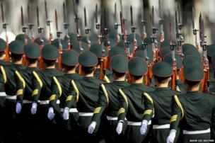 Soldiers from the guard of honour arrive for a welcome ceremony for India's Prime Minister Manmohan Singh in Beijing