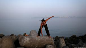 A man exercises on the shore of the Arabian Sea in Mumbai