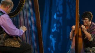 Robin Huw Bowen and Rhiain Bebb playing the triple harp