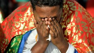 An Eritrean man at a ceremony to remember victims of this month's Lampedusa shipwreck, Agrigento in Sicily, Italy - Monday 21 October 2013