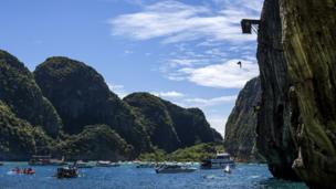 Gary Hunt of the UK dives from the 27 metre platform at Maya Bay in the Andaman Sea during the final stop of the 2013 Red Bull Cliff Diving World Series.