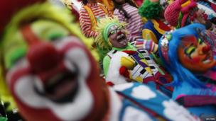 """Clowns laugh for fifteen minutes as rally for peace during 18th Latin American clown convention or """"Fair of laughter"""" at Mother Monument in Mexico City"""