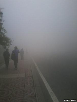 People barely visible in smog in Harbin north-eastern China. Photo: Daniel Ketui
