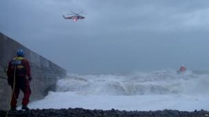 Coastguard helicopter and the Newhaven lifeboat searching for a missing teenager who was washed into the sea this afternoon at West Beach, Newhaven