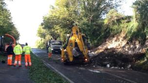 A digger clearing earth blocking the Weymouth Relief Road