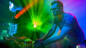 A DJ at the Glee Club