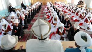 Kyrgyz brides and bridegrooms attend a mass wedding ceremony in the capital Bishkek