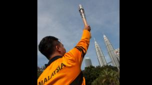 The Queen's Baton, with PETRONAS Towers in the background, in Kuala Lumpur, Malaysia.