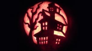 Haunted house carving by Sean Dooley