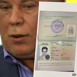 Lawyer Anatoly Kucherena shows the document allowing Edward Snowden to remain in Russia (file photo)