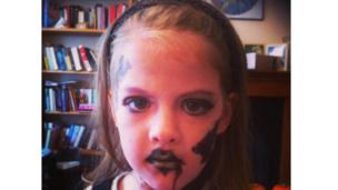 Florence wearing spooky make up