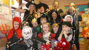 staff and children dressed for Halloween
