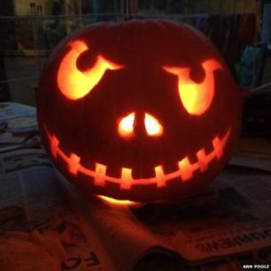 Traditional pumpkin carved as a face.