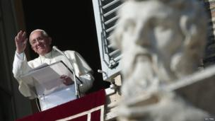 Pope Francis leads the Angelus prayer to celebrate All Saints' Day in Saint Peter's Square at the Vatican (1 November 2013)