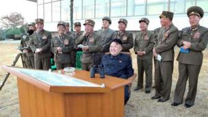 This undated photo released by North Korea's official Korean Central News Agency (KCNA) shows North Korean leader Kim Jong-Un (C) during a military firepower drill at an undisclosed location (photo released 1 November 2013)