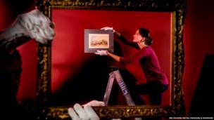 Jenny Lund, Curator of Fine Art at the Royal Pavilion & Museums hanging the Turner watercolour, Brighthelmston, Sussex,