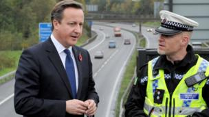 Mr Cameron meets with Traffic Police Inspector Rob Gwynne-Thomas overlooking the M4