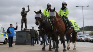 Police on duty before the match