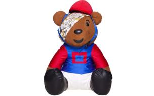 Bear in a blue and red riding outfit.