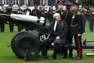 The Mayor of London Boris Johnson joins members of the Armed Forces and volunteers to fire a salute from a 105mm light gun to launch the London Poppy Appeal