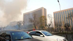 In this photo released by Xinhua News Agency, smoke billows after explosions on the Yingze Street in Taiyuan, Shanxi Province, 6 November 2013