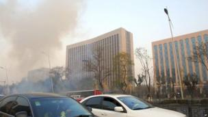 Smoke billows from the site of a series of explosions on Yingze Street in Taiyuan, capital of Shanxi province