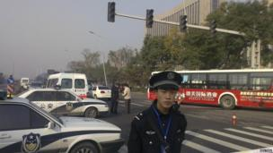 A police officer stands guard in front of the Shanxi Province Communist Party office building in Taiyuan