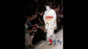 An audience member takes their seat for Fashion in Motion: Kansai Yamamoto at the V&A, London, 1 November 2013.