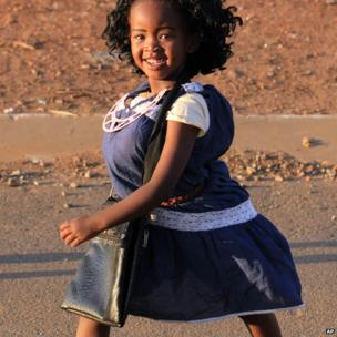 A young girl is dressed up as walks on the street as she celebrates Guy Fawkes in Thokoza south of Johannesburg, South Africa, Tuesday 5 November 2013