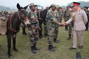 Prince Charles meets troops during a visit to the Indian Military Academy in Dehradun, India