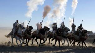 Horse riders perform with guns to celebrate the 38th anniversary of the now famous Green March on Wednesday near city of Fes on 6 November 2013