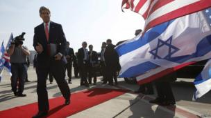 US Secretary of State John Kerry walks to his plane after a private meeting with Israeli Prime Minister Benjamin Netanyahu in Tel Aviv.