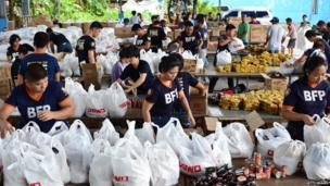 Bureau of Fire Protection volunteers pack relief goods at government warehouse on in Manila, Philippines. 9 Nov 2013