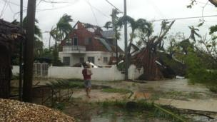 Storm damage, trees down and roof of house destroyed. Photo: Darren White